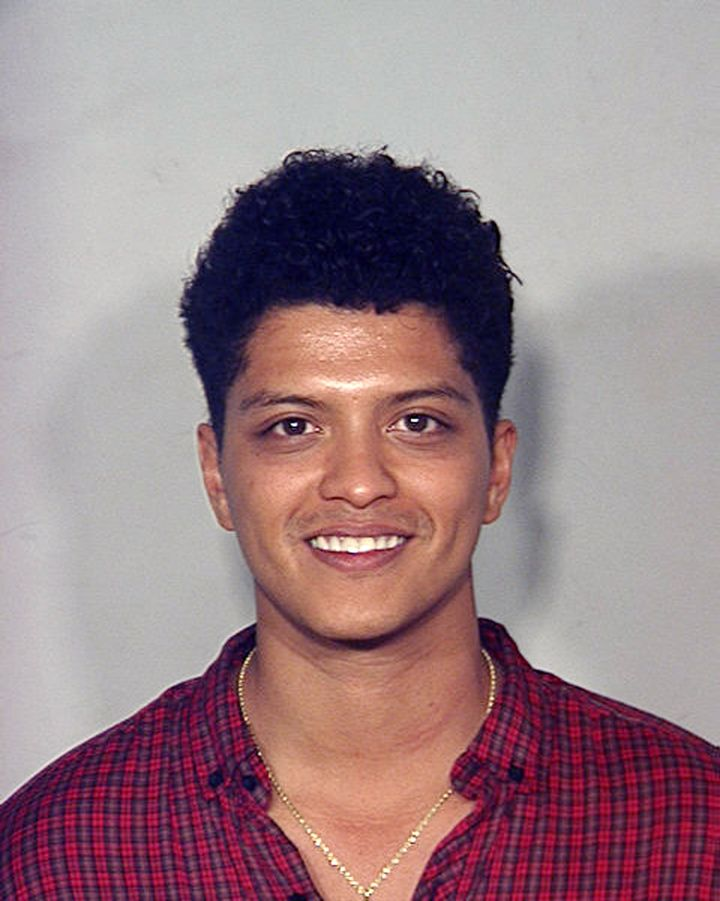 Bruno Mars poses for a mugshot in 2010.
