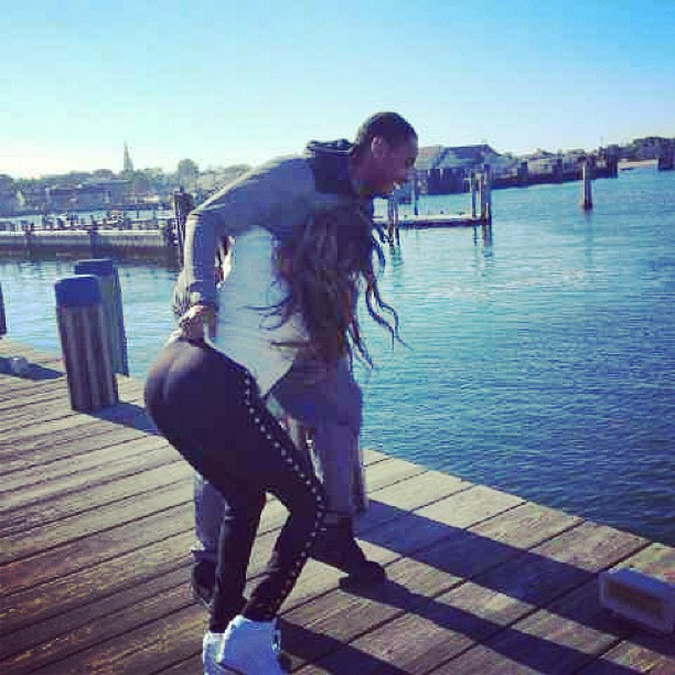 She Got A Donk: Carmelo makes a fake attempt at throwing his wifey in the river.