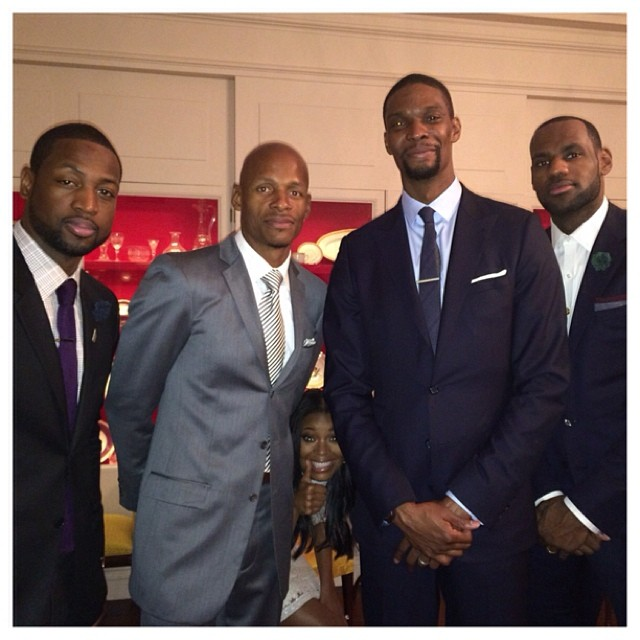 Gabby makes the perfect photobomb at the White House with the Miami Heat.
