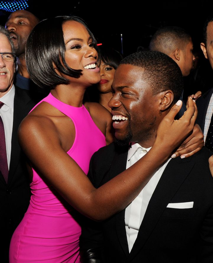"""Ride Along"" co-stars Tika Sumpter and Kevin Hart celebrate and share a hug during the movie premiere after party."
