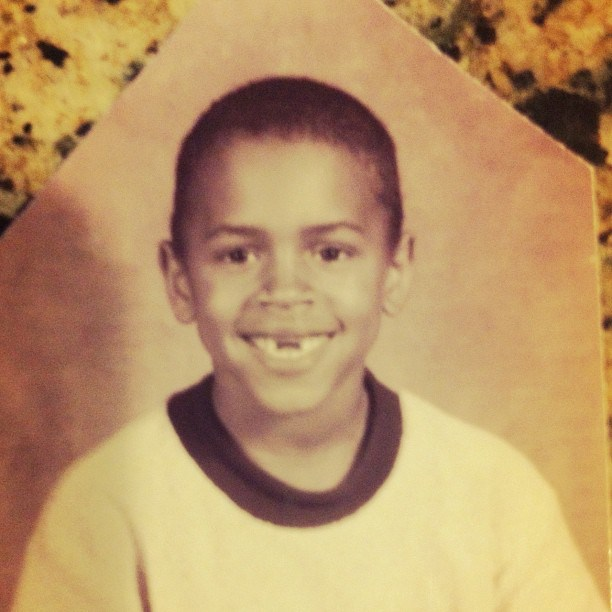 Young Chris smiles, but he's missing a tooth.