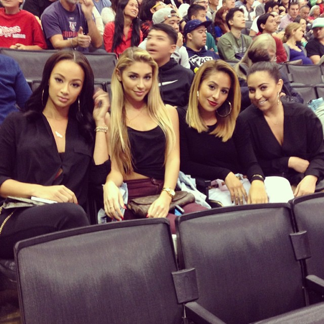 Sitting courtside at basketball games with Draya.