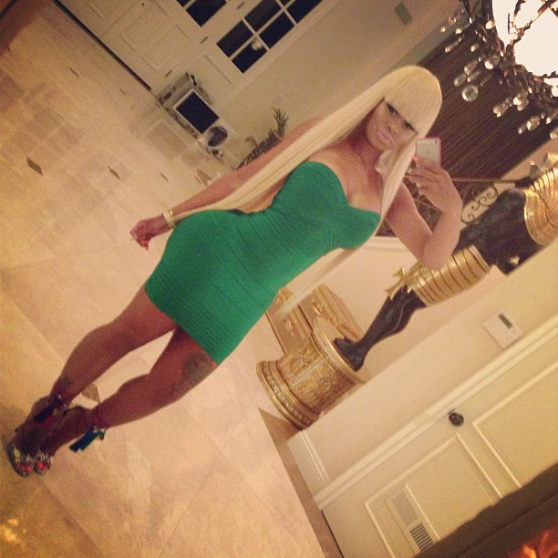 Blac Chyna shows off her booty in green.