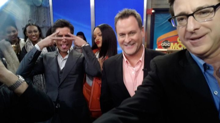 Rihanna flicks it up with the men of the Full House at Good Morning America.