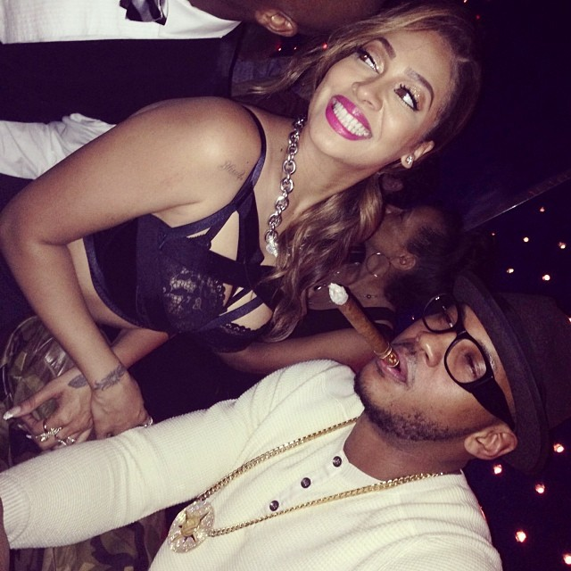 Melo puffs on a cigar as LaLa beams with happiness in her sexy ensemble.