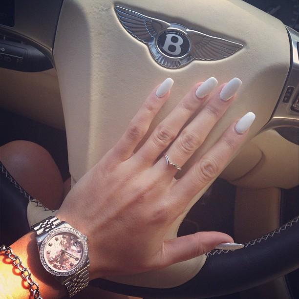 Driving a Bentley.