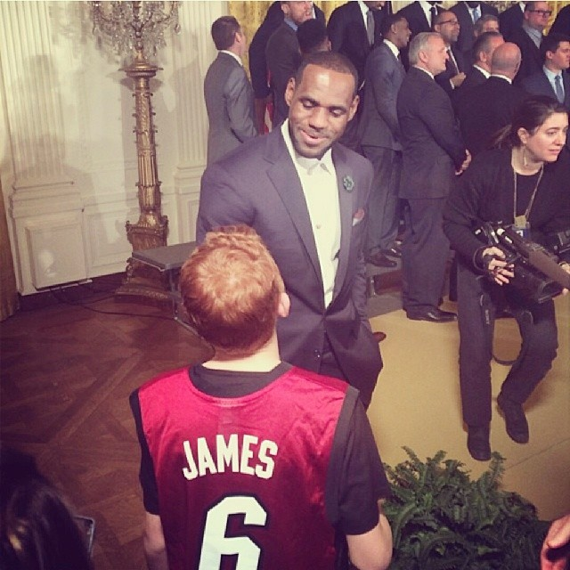 "LeBron James takes the time out of his visit to talk to a fan. ""Had to step away from the pack and chat with him. Great meeting u kid! #GladICanBeARoleModelToYou #StriveForGreatness"" he wrote on Instagram."