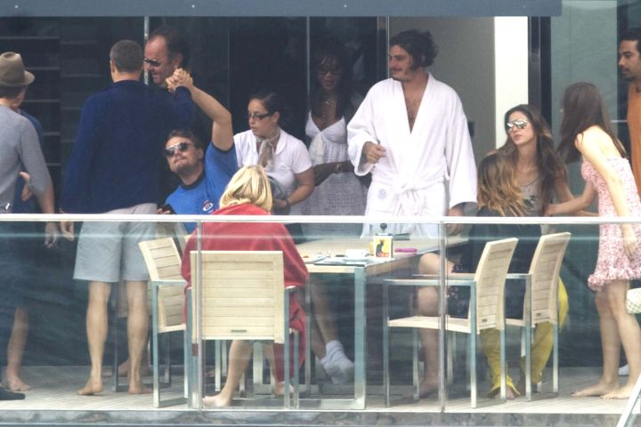 Leo toasts to the good life with Naomi Campbell and friends as they vacation in Italy.