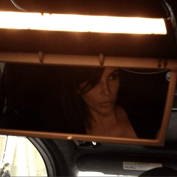 Kim sneaks in a quick selfie in the car