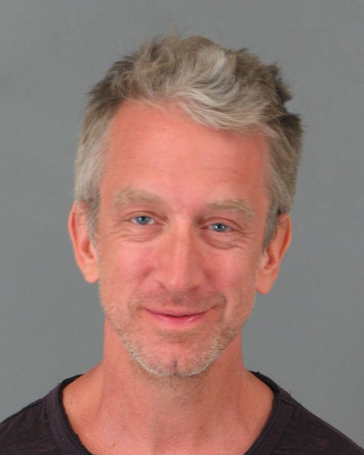 Andy Dick smirks in his mugshot after being arrested at a restaurant in Cali, for allegedly being under the influence.
