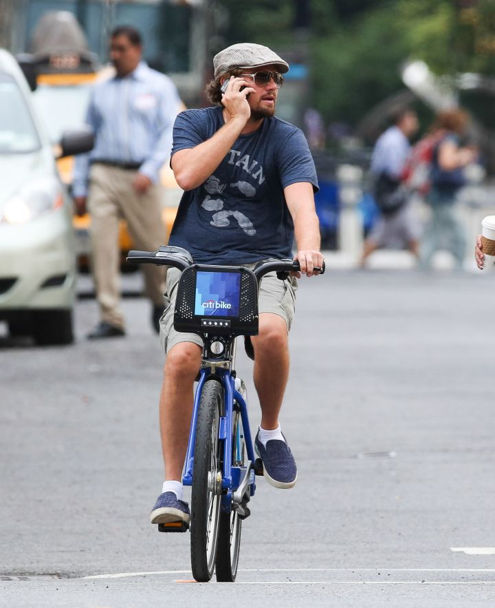 Only ballers ride Citi bikes and talk on the phone at the same time.