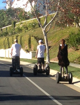 Biebs and Selena have some young fun on Segways.