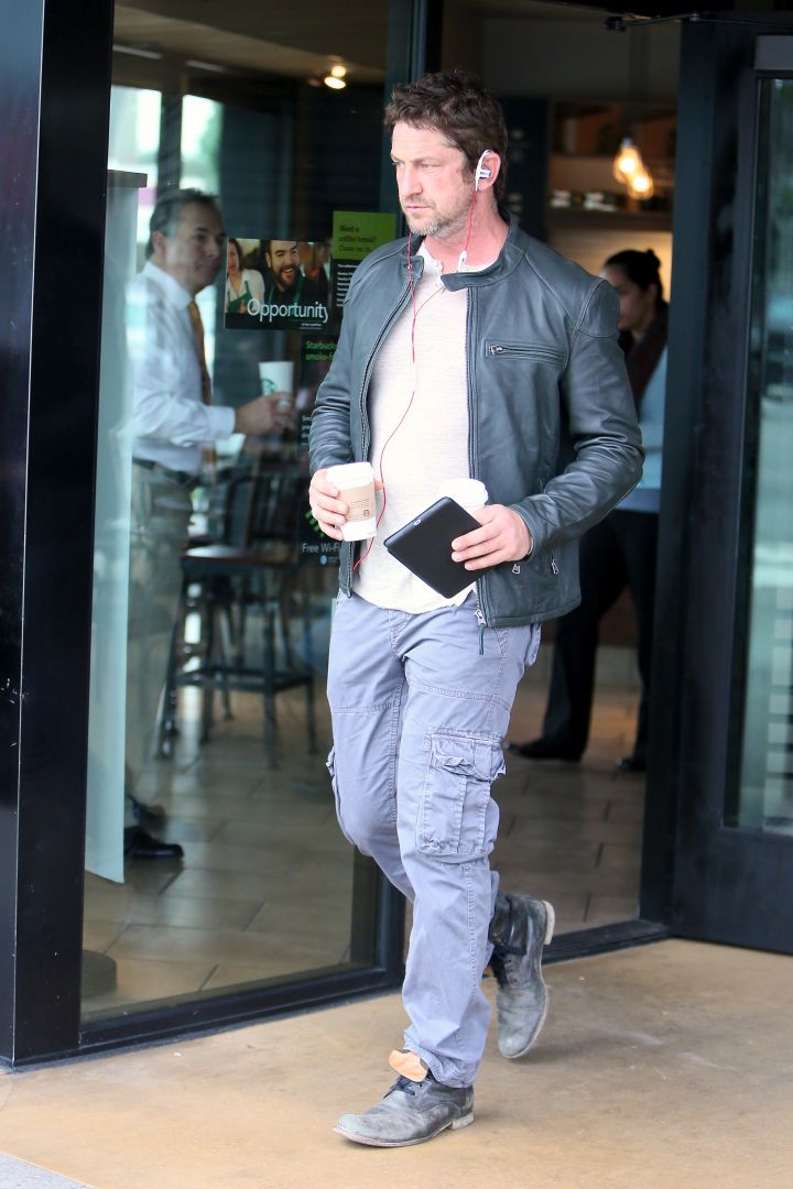 Cup of Joe! Gerard Butler looked handsome in a casual 'fit as he carried two coffees out of Starbucks.