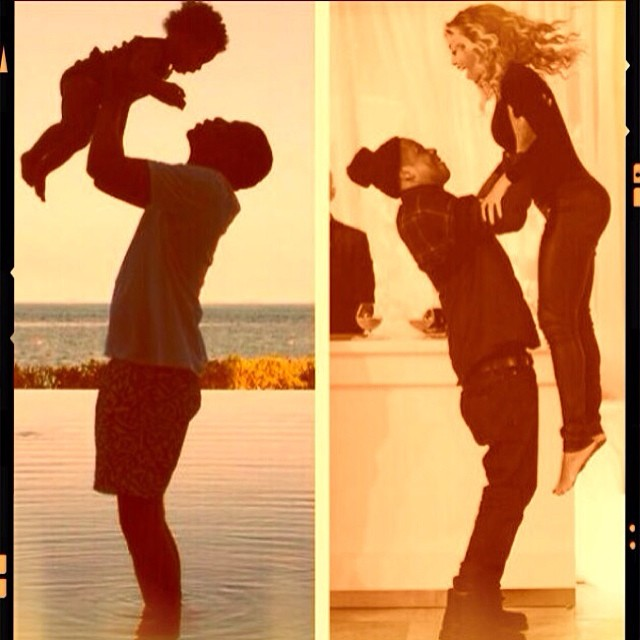 Jay Z lifts his two favorite women in the air.