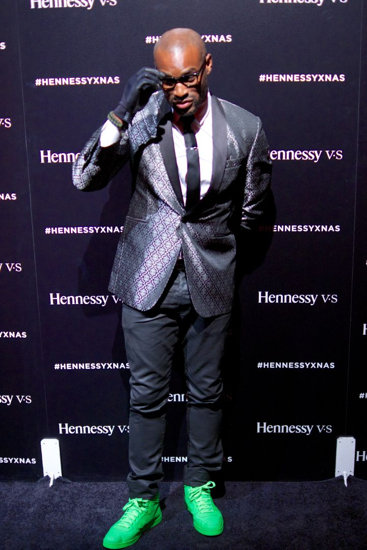 Tyson Beckford killing it with the sneakers and suit combo.