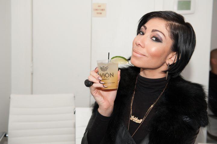 Bridget Kelly sips casually on an Avion drink.