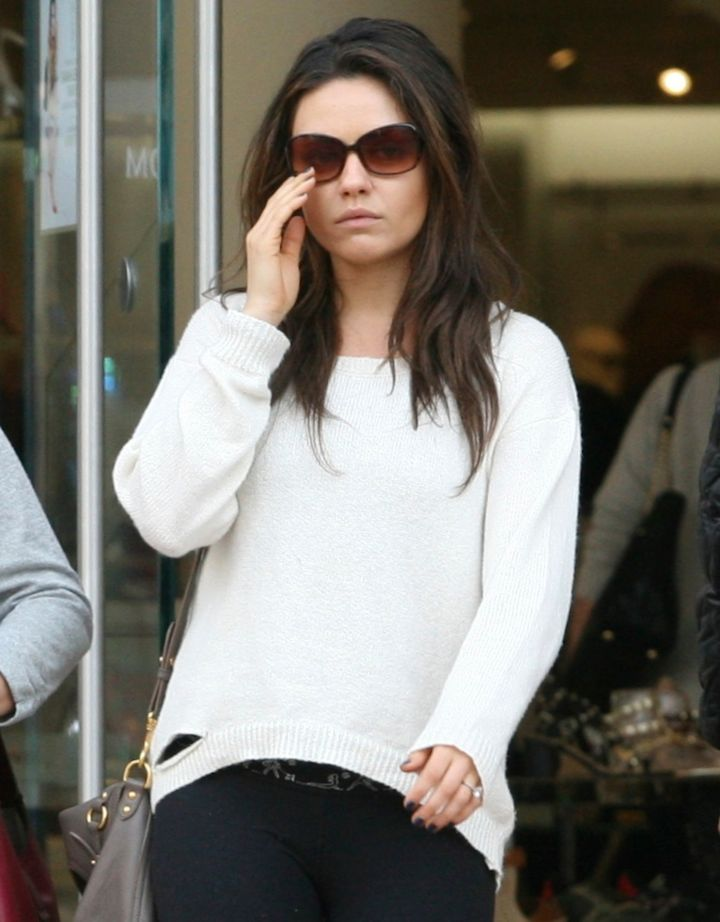 We spy with our little eyes a big rock on Mila Kunis ring finger!