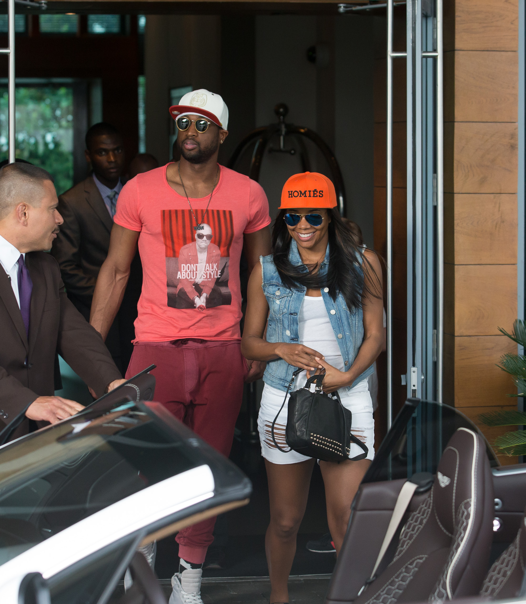 Dwyane Wade feeds his fiance Gabrielle Union pizza during a romantic lunch in Miami