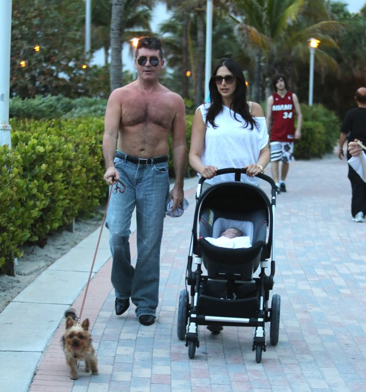 Simon Cowell showed off his post-baby body while hanging out with his son, Eric, and girlfriend, Lauren Silverman.