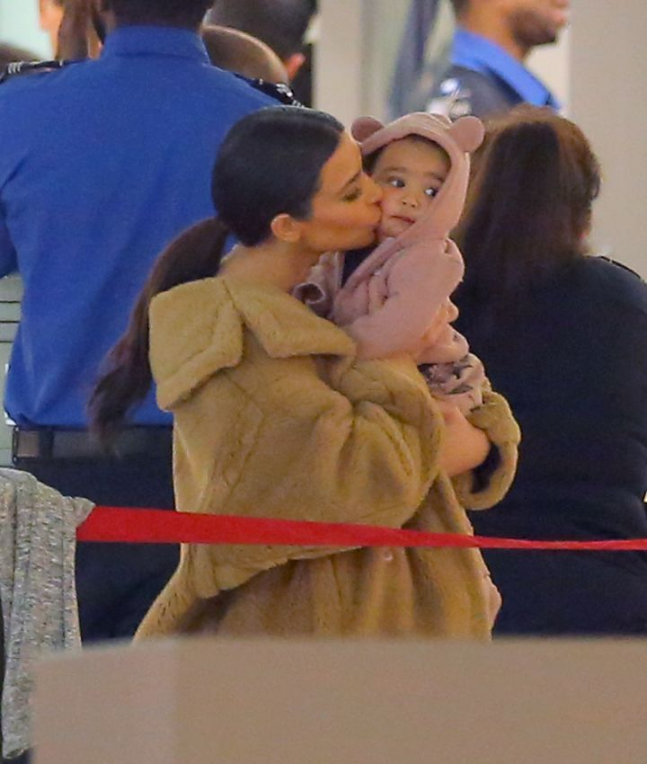 North at the airport in her onsie was the perfect Valentine's Day gift from them to us.