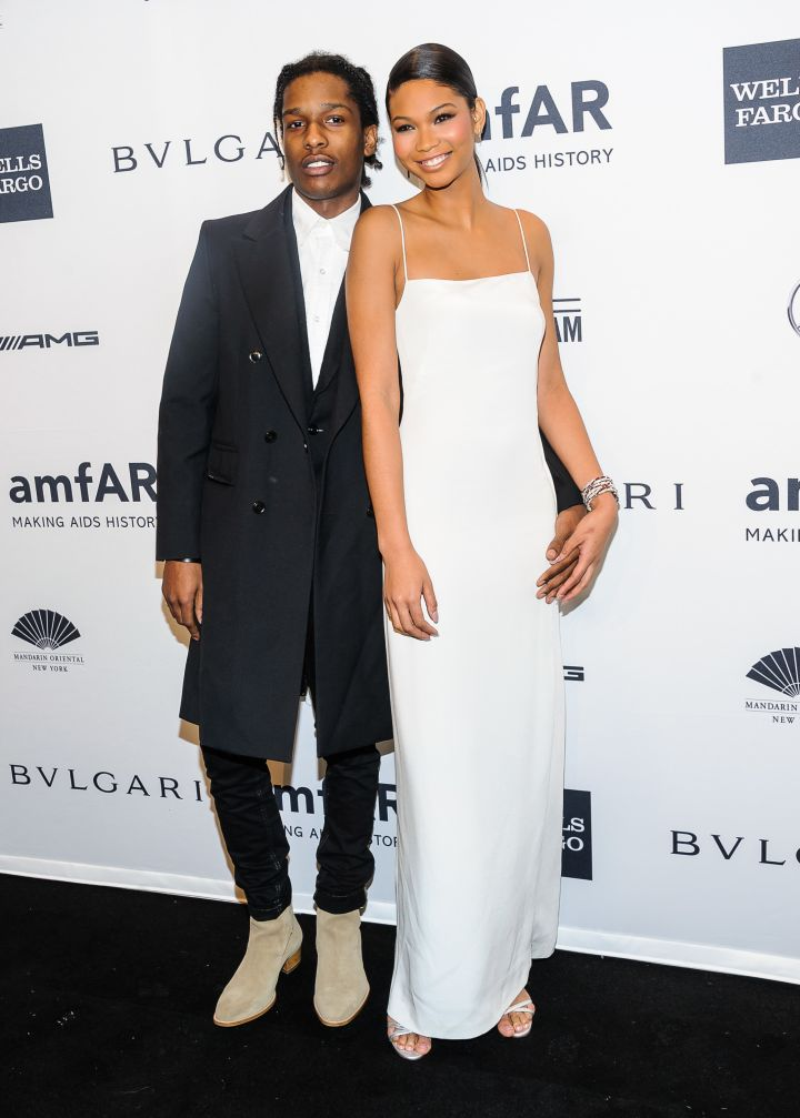 A$AP Rocky and Chanel Iman show off their million dollar smiles at the Mercedes-Benz amfAR Gala in NYC.