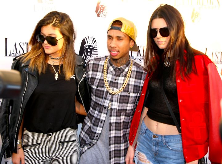 Kendall and Kylie on Tyga's arm before Kylie went punk rock pretty.