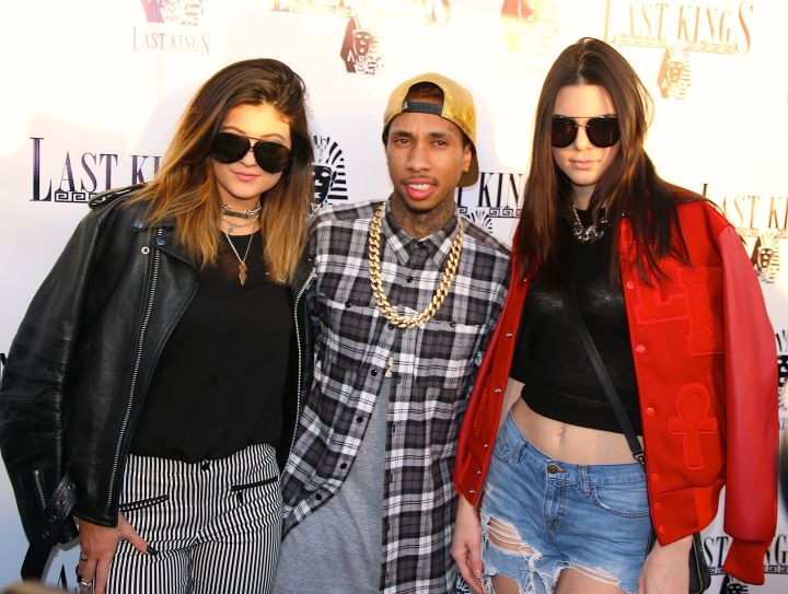 Tyga has the two coolest girls in town on his arm.