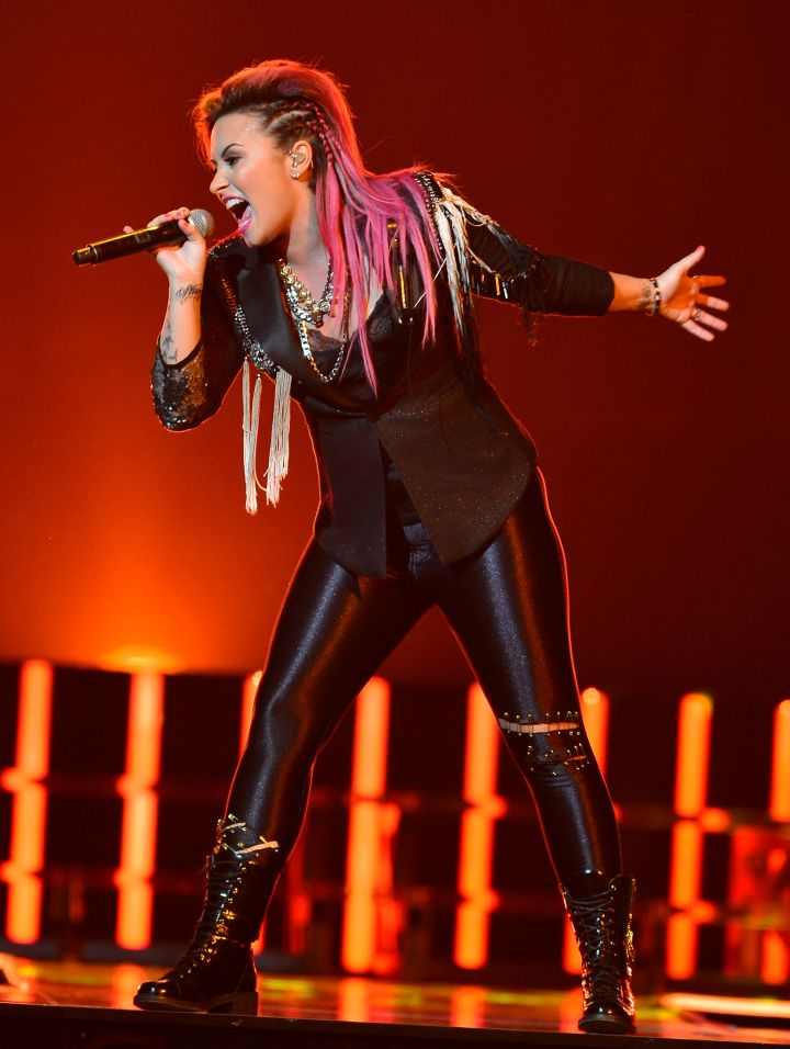 Demi Lovato rocked out while performing live in concert at BB and T Center.