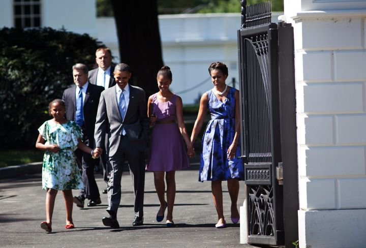 The Obamas step out in their Sunday best for a stroll to church.