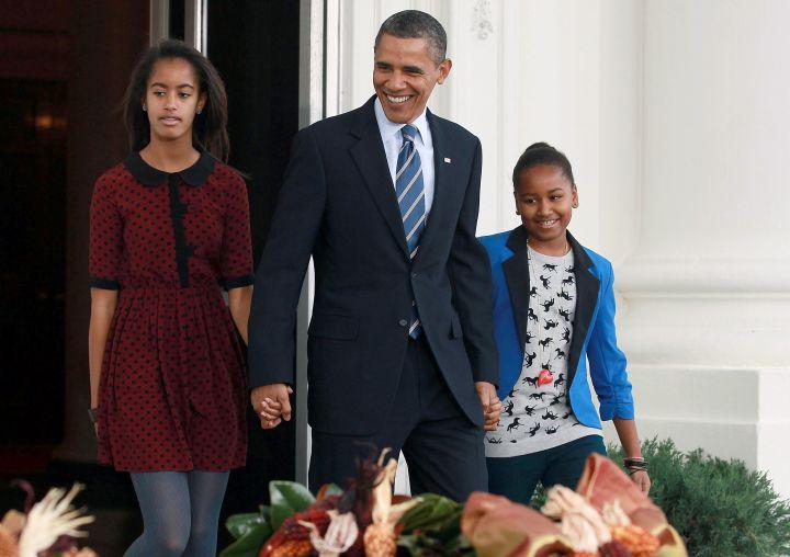 Barack and his girls pardon the National Thanksgiving turkey.