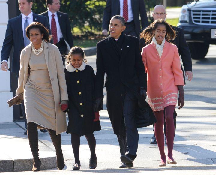The Obamas bundle up for Sunday mass.