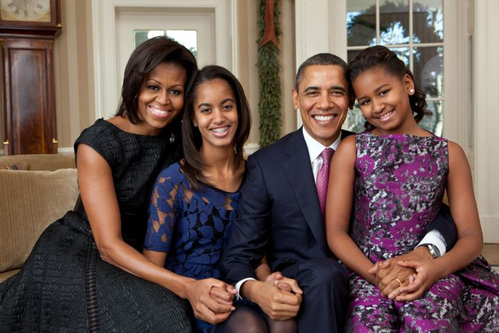 The family poses for a portrait with Michelle in Byron Lars and Sasha in BB Dakota on the ends.