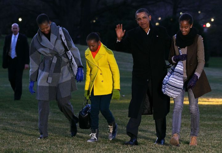 The First Family returns from vacation in their winter wear.