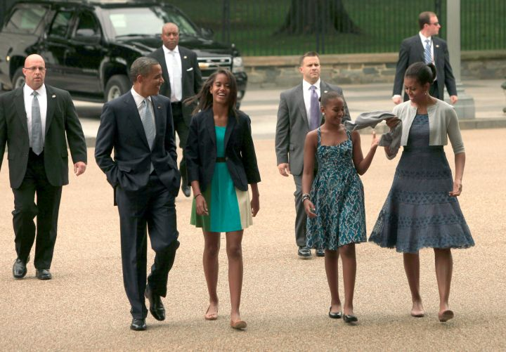 The Obamas are feeling blue en route to church.