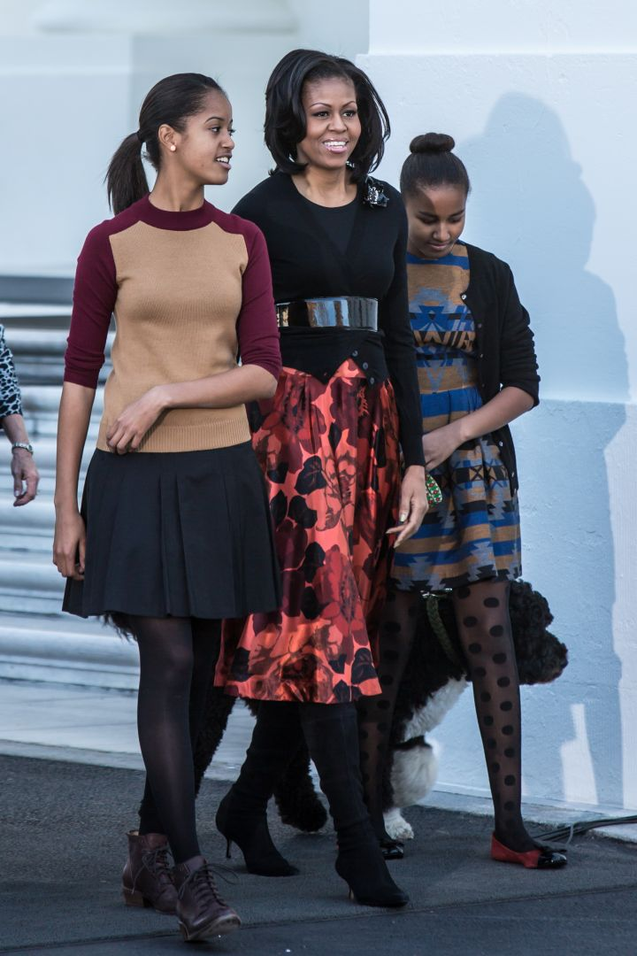 Malia and Sasha get their style from their momma.