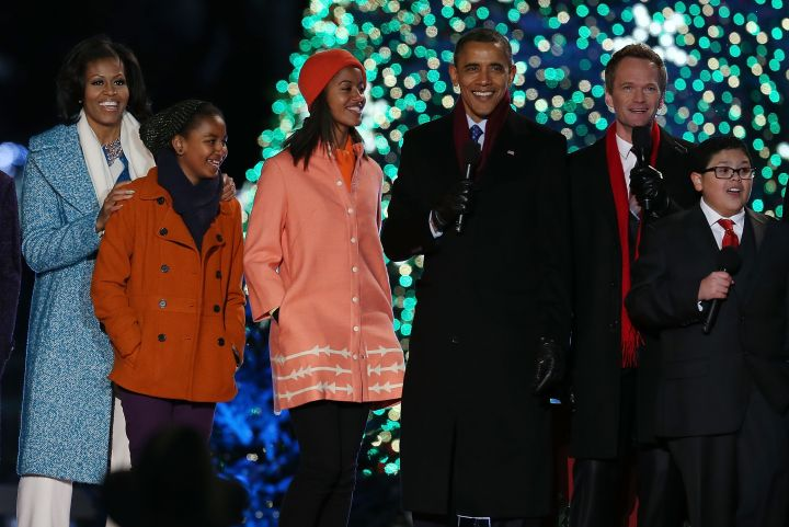 The Obamas are warm and cozy during the annual lighting of the National Christmas tree.