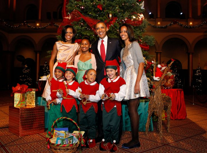 The Obamas attend a Christmas ceremony in Washington.