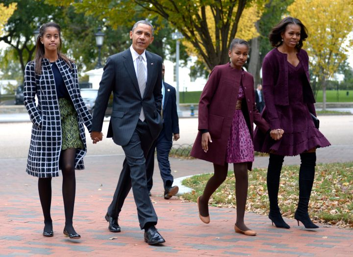 Malia (in a fabulous geometric print coat) and Barack coordinate in gray, while Sasha and Michelle go for purple on the way to church.