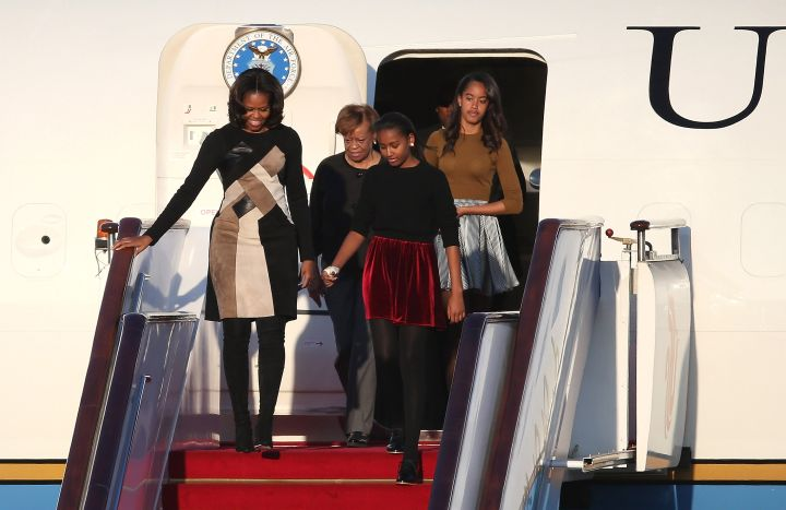 Sasha and Malia join Michelle Obama, wearing Derek Lam, for a trip to China.