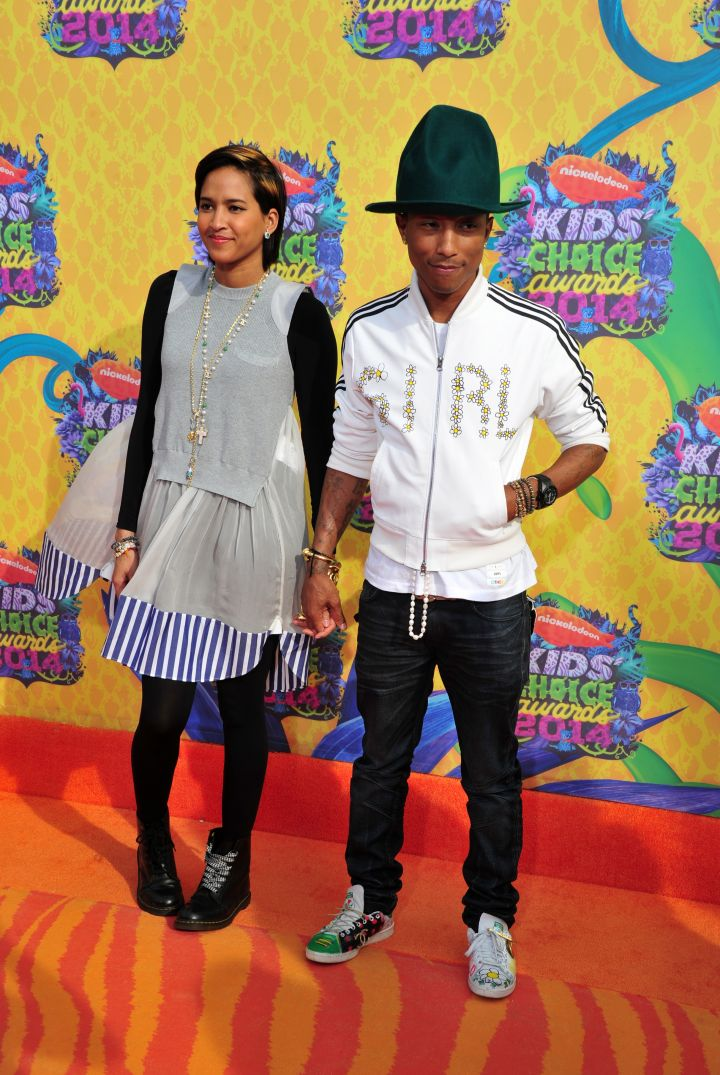 Pharrell and his hat in a custom Adidas firebird jacket with wife Helen