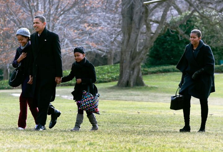 The Obamas in all black everything.