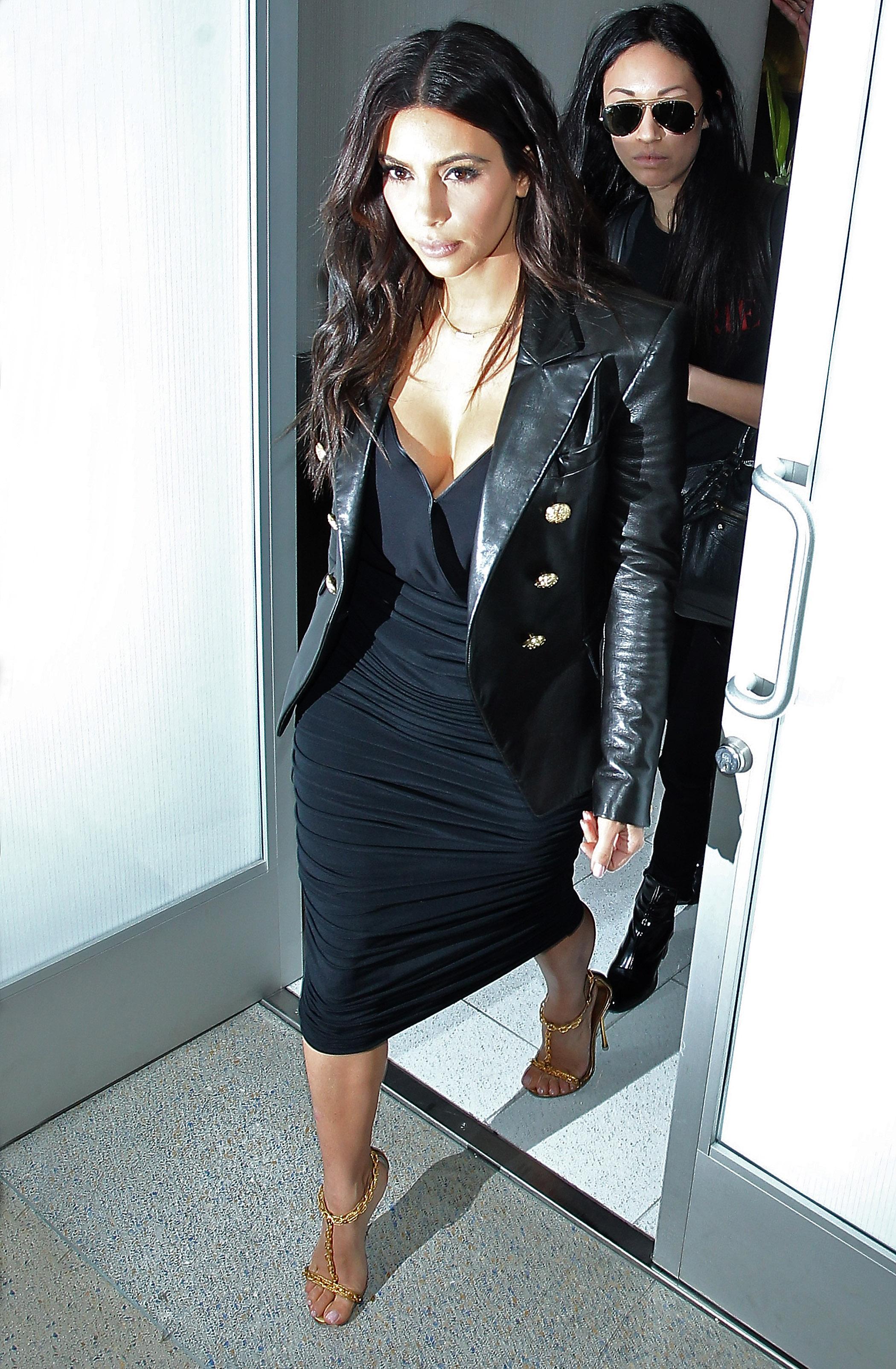 Kim Kardashian, Kourtney Kardashian and Khloe Kardashian leave on a flight from Los Angeles International Airport
