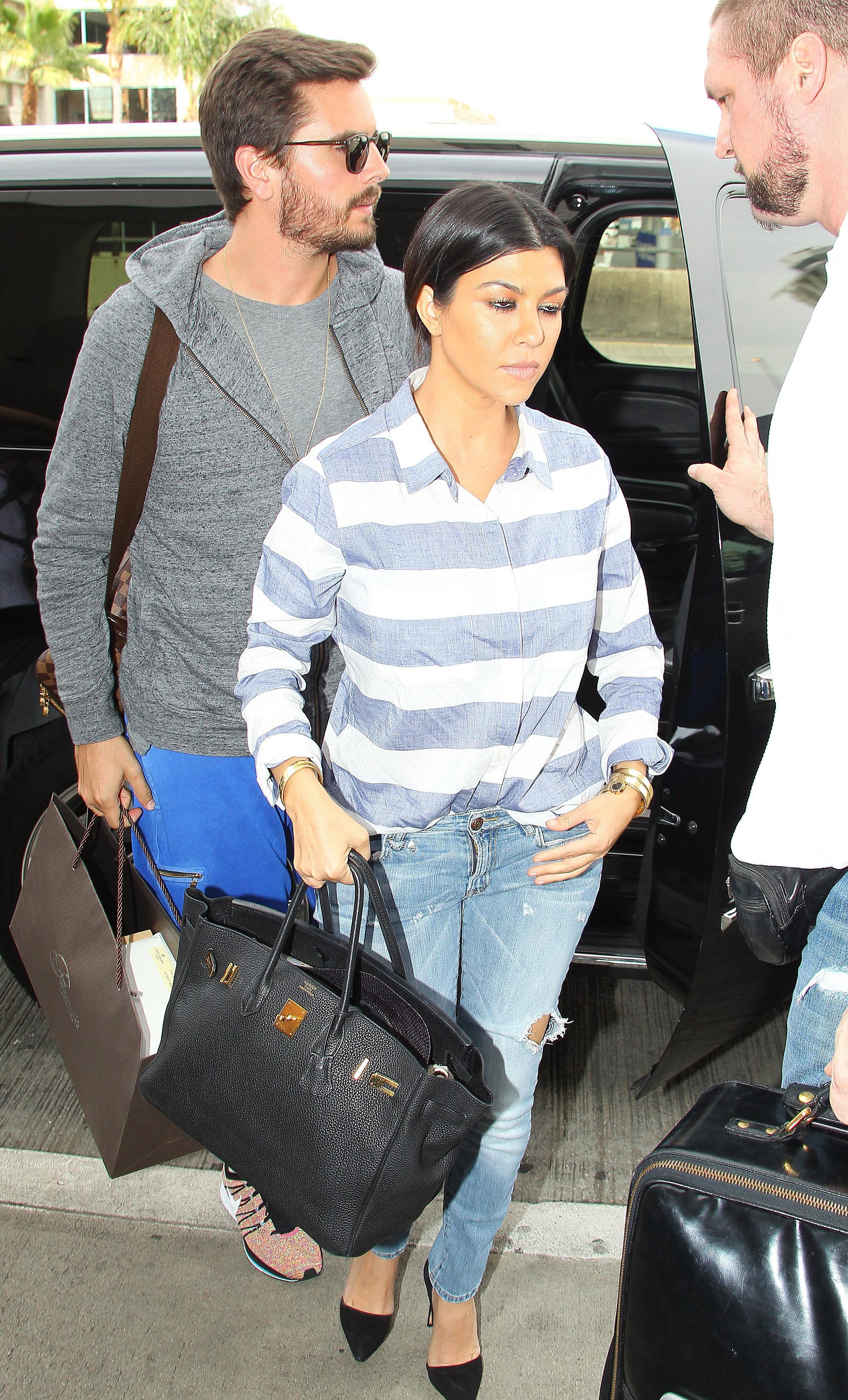 Kim Kardashian, Kourtney Kardashian and Khloe Kardashian arrive at LAX Airport