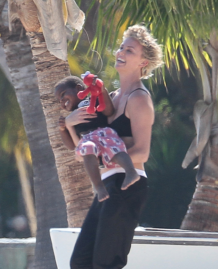 Charlize Theron and her son Jackson playing around on the beach in Miami