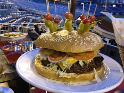 The StrasBurger at Nats Park in Washington is one big and expensive burger ($59 to be exact). It's 8 pounds, so you'll literally have a food baby after getting through with this.