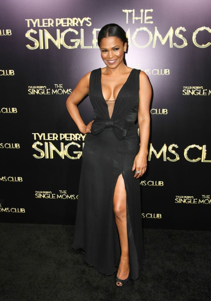 Nia Long dazzles as she bares some boobage and her pearly white smile in all black.