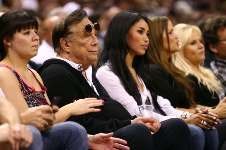 Donald Sterling sitting with his girlfriend at the game. No blacks around them.