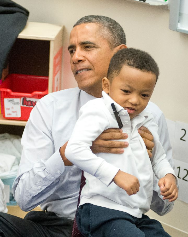 Obama loves the kids…even when they're a chore to pick up.