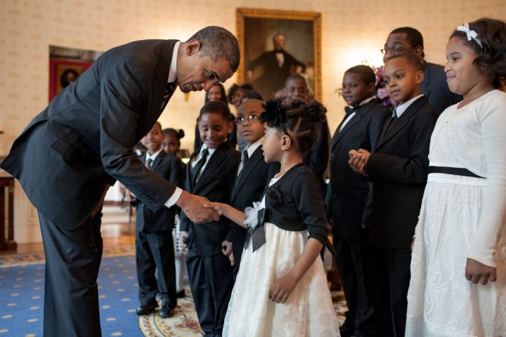 Obama greeting little visitors dressed to the nines.