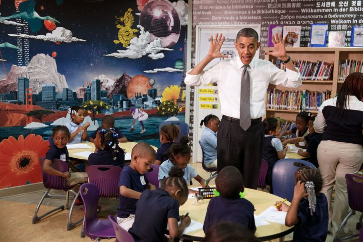 President Obama gives an animated expression while meeting with students at an elementary school.